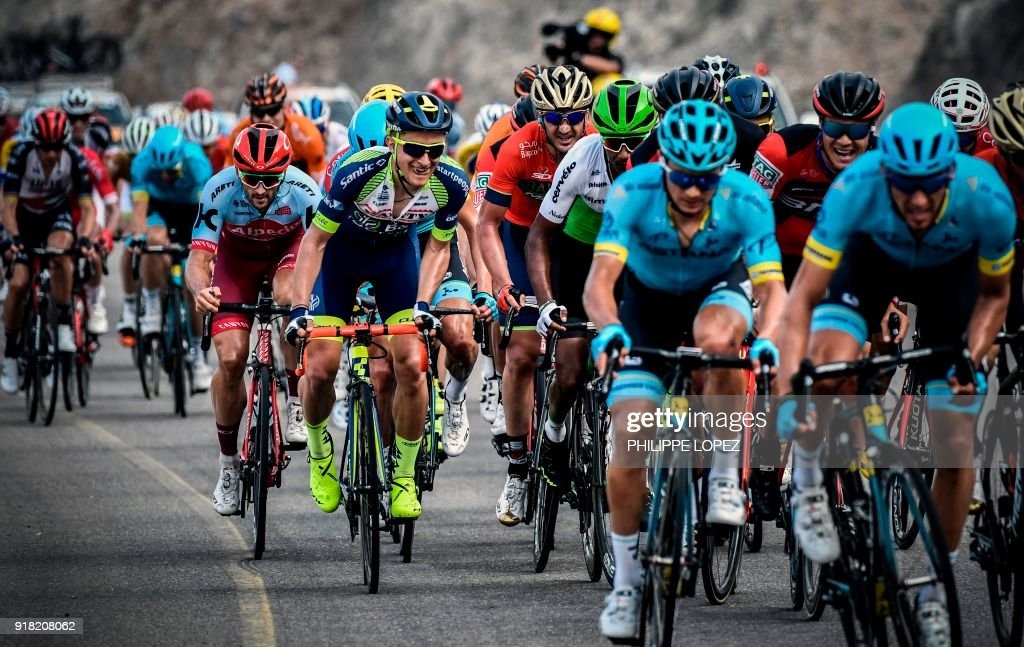UCI WorldTeam Team KatushaAlpecin's Australian rider Nathan Hass (L, red helmet) rides before winning the second stage of the 2018 cycling Tour of Oman, from Sultan Qaboos University to Al-Bustan, west of the capital Muscat on February 14, 2018. / AFP PHOTO / Philippe LOPEZ