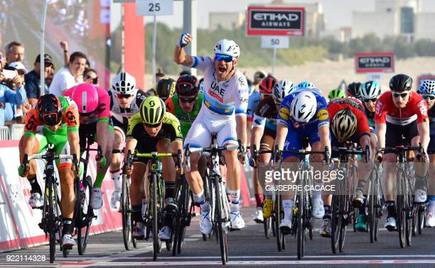 WorldTeam UAE Team Emirates' Norwegian cyclist Alexander Kristoff celebrates as he crosses the finish line during the first stage of the 2018 Abu...