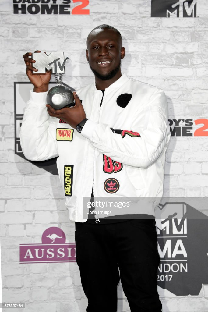 Worldwide Act award winner Stormzy poses in the winner's room during the MTV EMAs 2017 held at The SSE Arena, Wembley on November 12, 2017 in London, England.