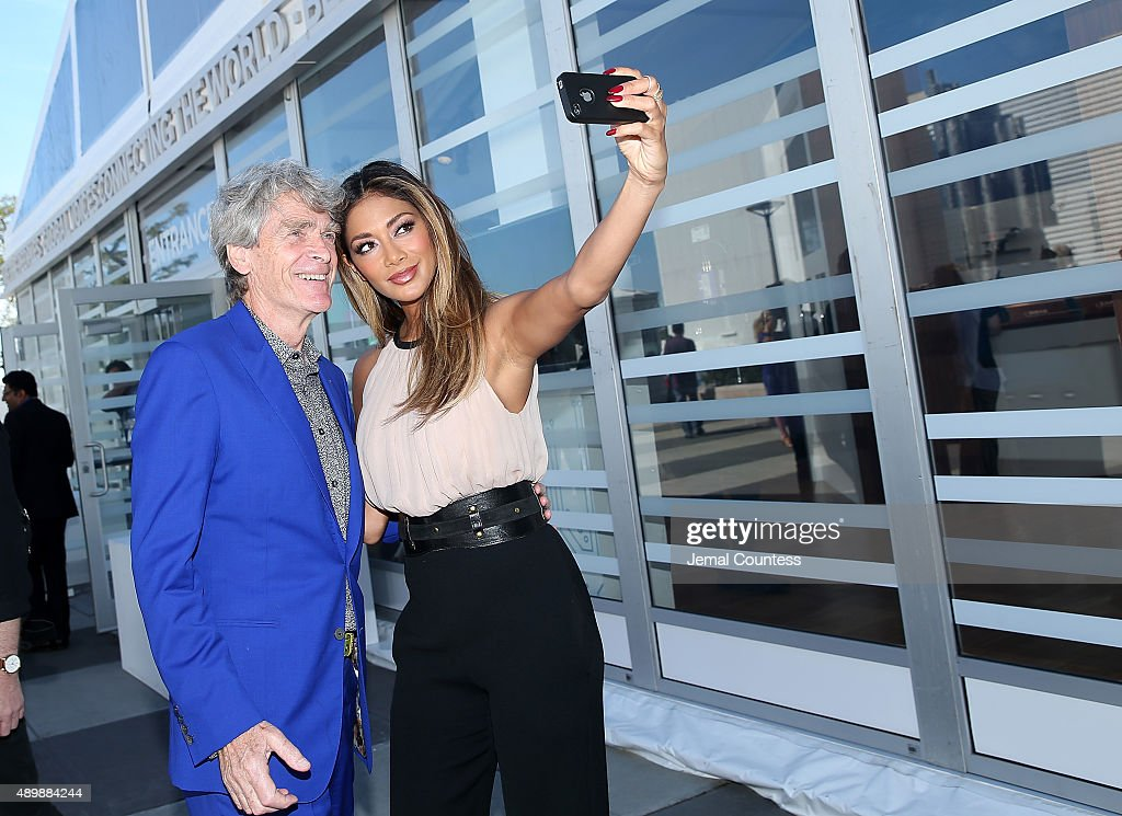Worldwide Creative Director and Founder of the BBC Sir John Hegarty and singer/actress Nicole Scherzinger take a selfie prior to the premiere of Global Goals 60 second Cinema Ad at the United Nations on September 24, 2015 in New York City.