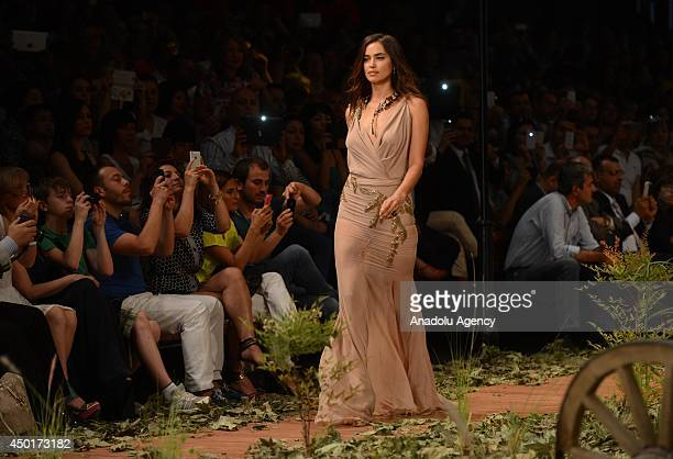 Worldwide known top model Irina Shayk walks on the podium at Dosso Dossi Fashion Show at Expo Center in Antalya, Turkey on June 6, 2014.