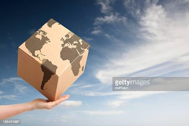 Worldwide trade cardboard box and world map
