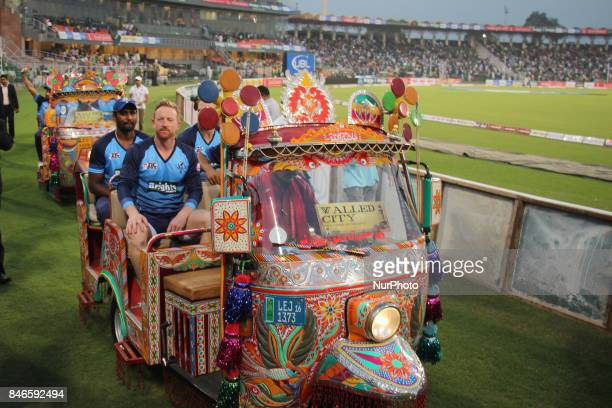 WorldXI cricket team players waving the spectators while enjoying a ride on traditional tricycle rickshaw at Gaddafi Cricket Stadium in Lahore on...