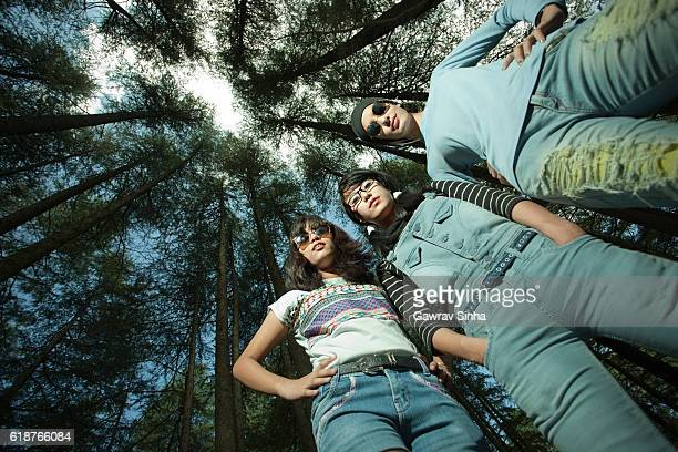worm eye view of confident female friends of different ethnicity. - garment stock pictures, royalty-free photos & images