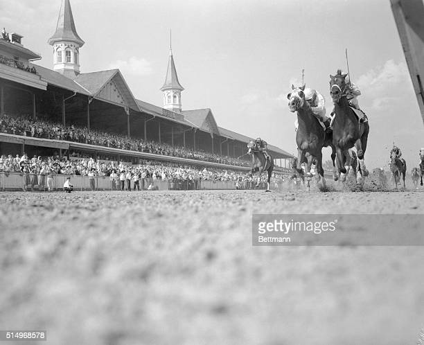 Worm's eye view of the finish of the 85th running of the Kentucky Derby. Winner was Tomy Lee, Willie Shoemaker up ; Sword Dancer, W. Boland up was...