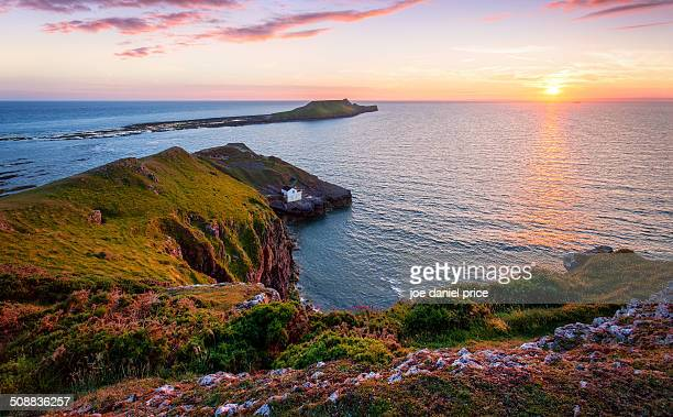 worm's head, gower, swansea, wales - gower peninsula stock photos and pictures
