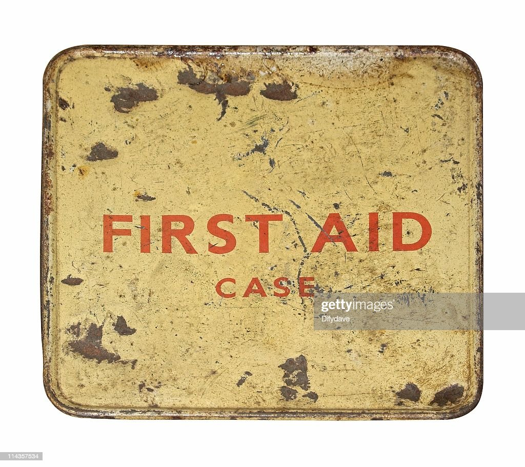 Worn And Dented Old First Aid Tin Front : Stock Photo