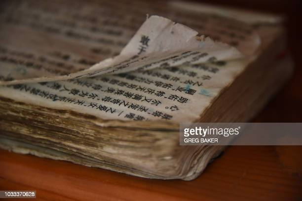 A worn bible is seen at the new governmentsanctioned Catholic cathedral in Xincun in China's central Henan province on August 12 2018