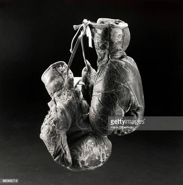 A worn boxing gloves