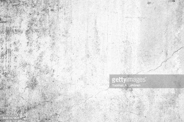 worn concrete wall texture background with paint partly faded, in black&white. - 汚れた ストックフォトと画像