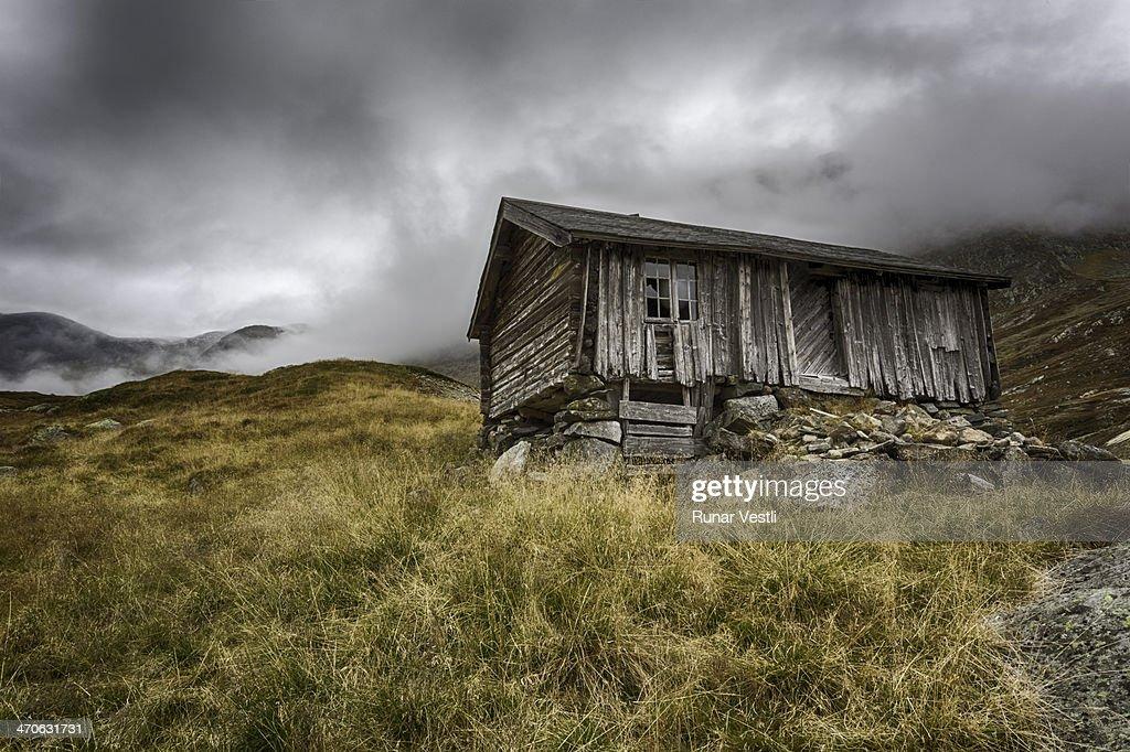 Worn old Norwegian wooden cabin. : Stock Photo