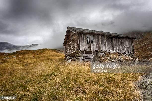 Worn old Norwegian wooden cabin.