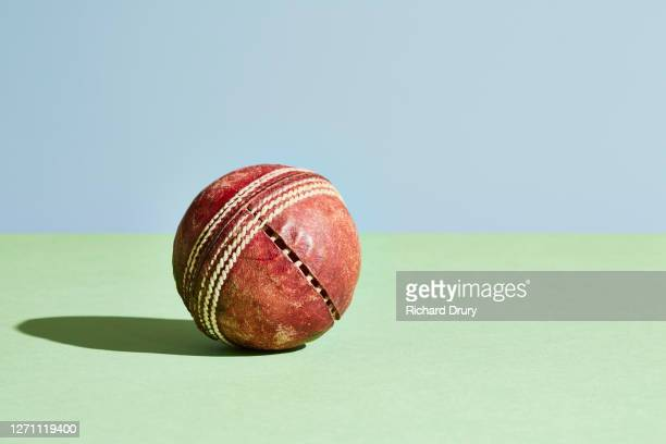 a worn out old cricket ball - sport of cricket stock pictures, royalty-free photos & images