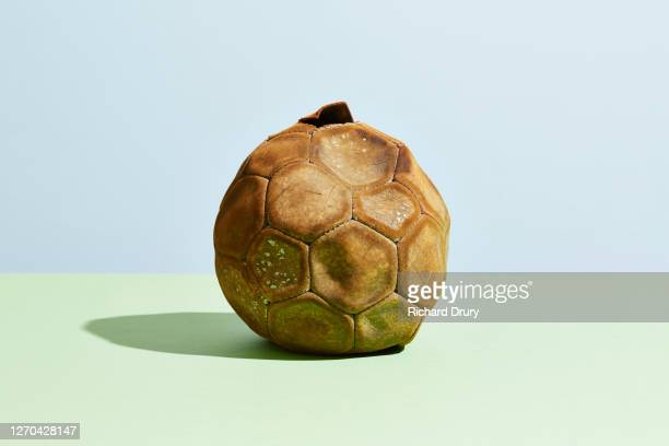 a worn out old soccer ball - richard drury stock pictures, royalty-free photos & images