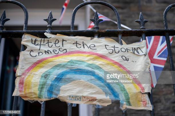A worn rainbow banner outside a house on May 08 2020 in Penygraig United Kingdom The UK commemorates the 75th Anniversary of Victory in Europe Day...