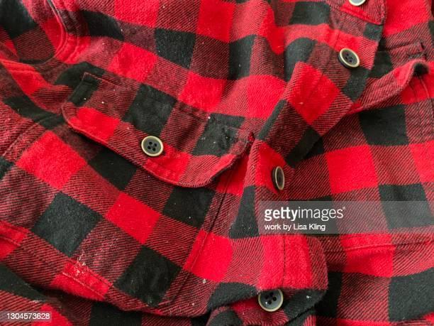 worn red flannel shirt - チェックシャツ ストックフォトと画像