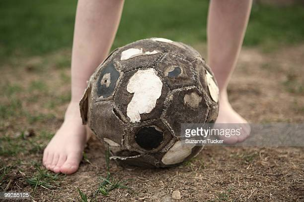 worn soccer ball - old american football stock photos and pictures