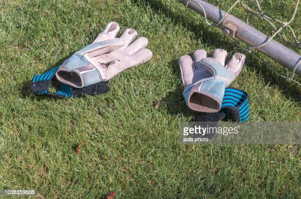 worn soccer goalkeeper sport gloves - goalkeeper stock pictures, royalty-free photos & images