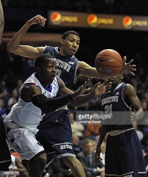 Worrel Clahar of the DePaul Blue Demons passes the ball under pressure from Greg Whittington of the Georgetown Hoyas at Allstate Arena on January 17...