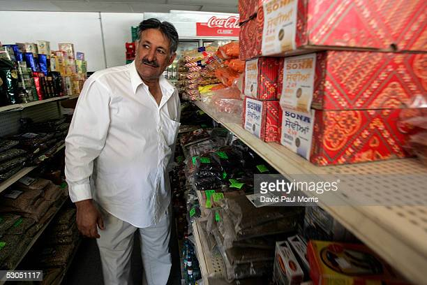 Worried about a backlash against Muslims Mumtaz Khan keeps a watchful eye on the front door of his store on June 10 2005 in Lodi California Lodi the...