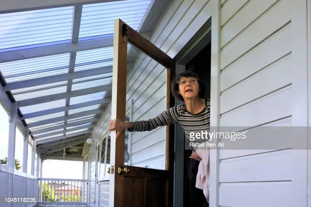 worried adult senior woman - rafael ben ari stock-fotos und bilder