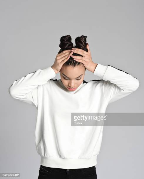 worried afro american teenager woman - looking down her blouse stock photos and pictures