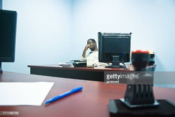 worried businessman entrepreneur sitting behind desk in office