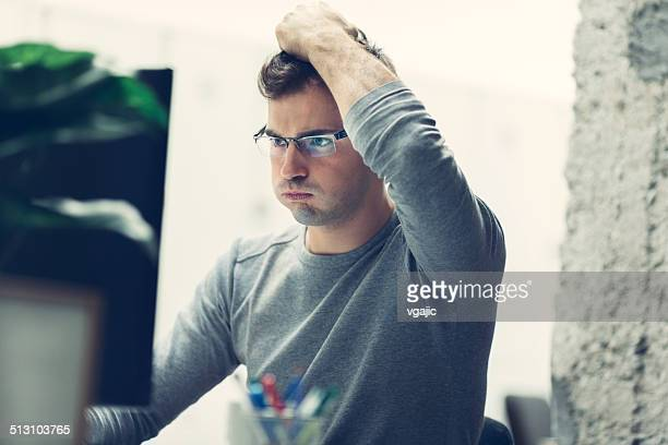 worried businessman in office. - head in hands stock pictures, royalty-free photos & images