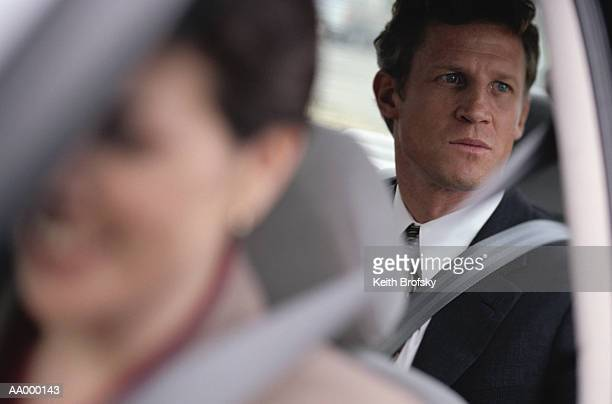 Worried Businessman Staring Out the Car Window
