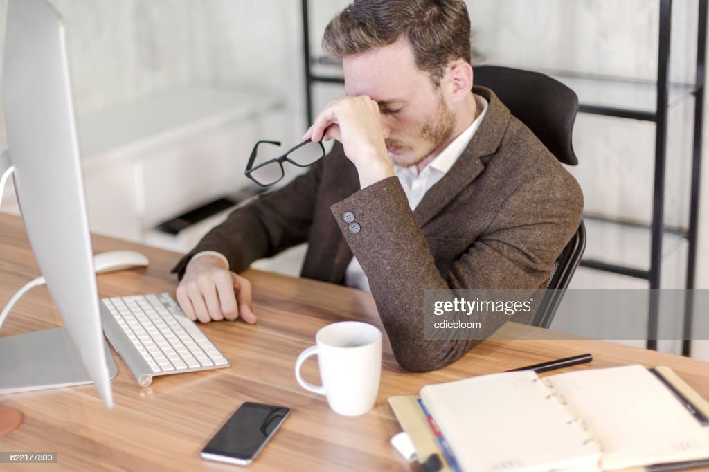 Worried businessman.Feeling exhausted : Stock Photo