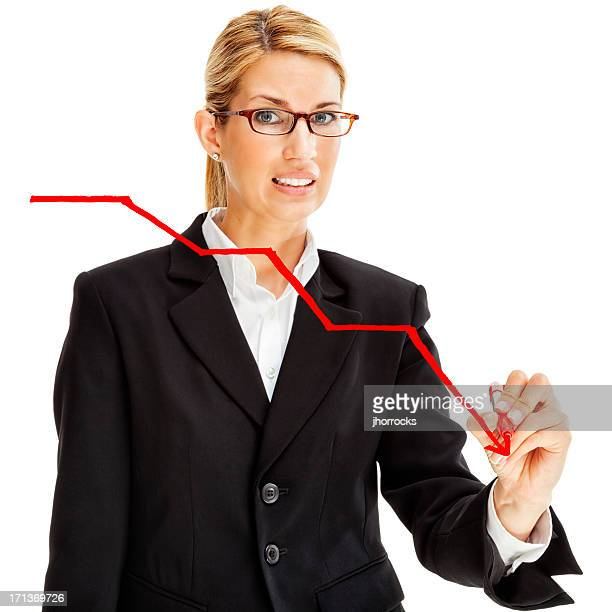 worried businesswoman drawing downward graph - stock trader upset stock pictures, royalty-free photos & images