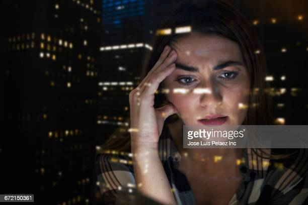 Worried Caucasian businesswoman with hand on head