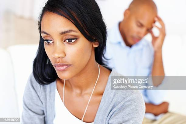 Worried couple at home