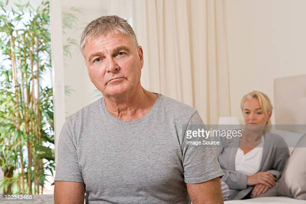worried couple in bedroom - erectile dysfunction stock pictures, royalty-free photos & images