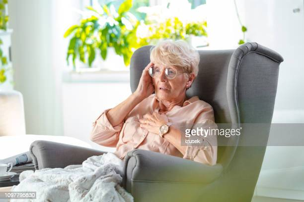 worried elderly lady having pain in chest - terrified stock pictures, royalty-free photos & images
