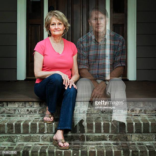 Worried Elderly Man Sitting Outside The House