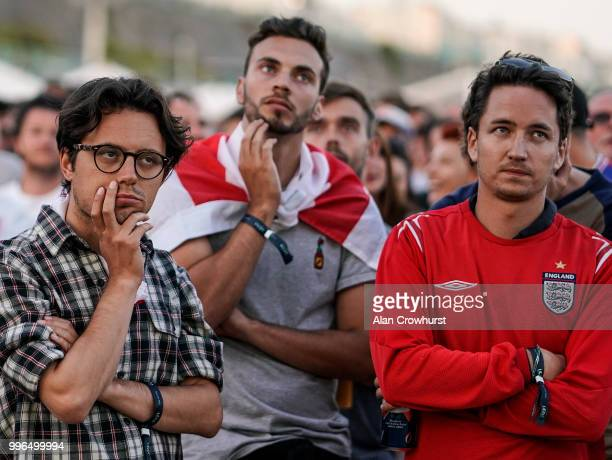 Worried England fans during the 2018 FIFA World Cup semi final match between Croatia and England at the Luna Beach Cinema on Brighton Beach on July...