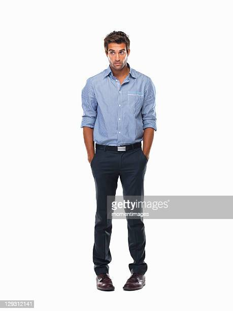 Worried executive standing with hands in pockets against white background