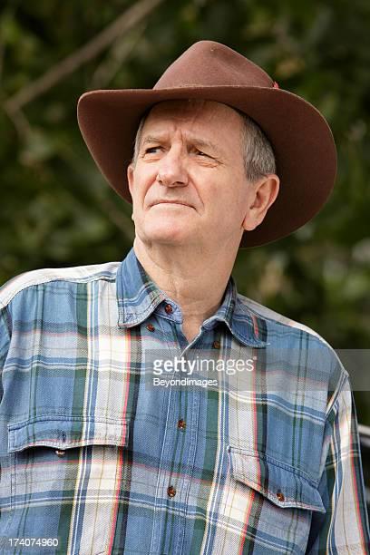 Worried farmer wearing bush hat