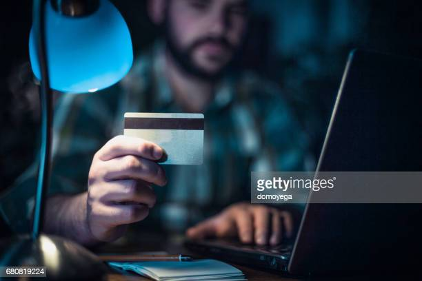 Worried man checking his bank account online