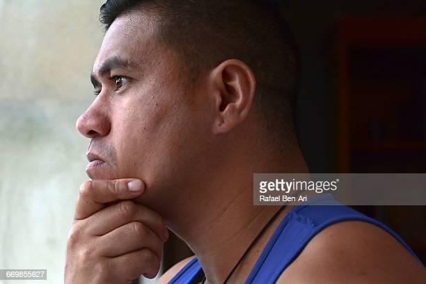 Worried Man Looks outside a window
