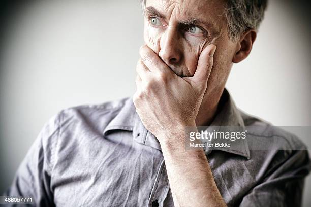worried man - hands covering mouth stock pictures, royalty-free photos & images