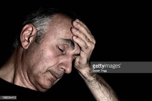 Worried man with hand on head
