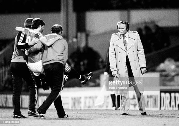 A worried Manchester United manager Ron Atkinson waits to see the extent of the injury sustained by striker Garry Birtles who is carried off during...
