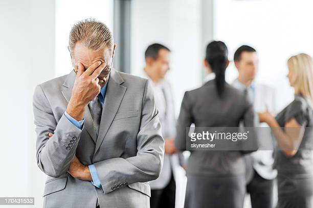 Worried mature businessman