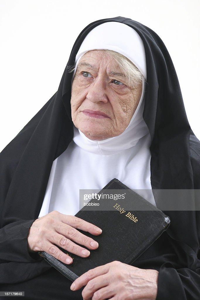 worried nun : Stock Photo