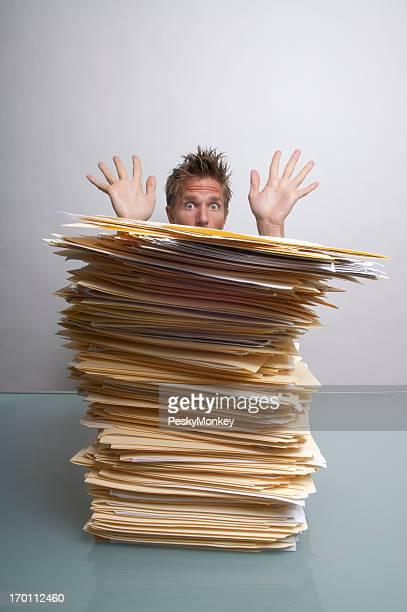 Worried Office Worker Peeks and Waves Over Paperwork