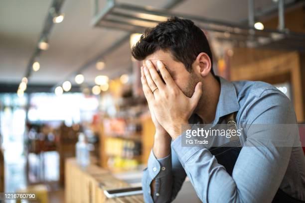 worried owner at his small business - falência imagens e fotografias de stock