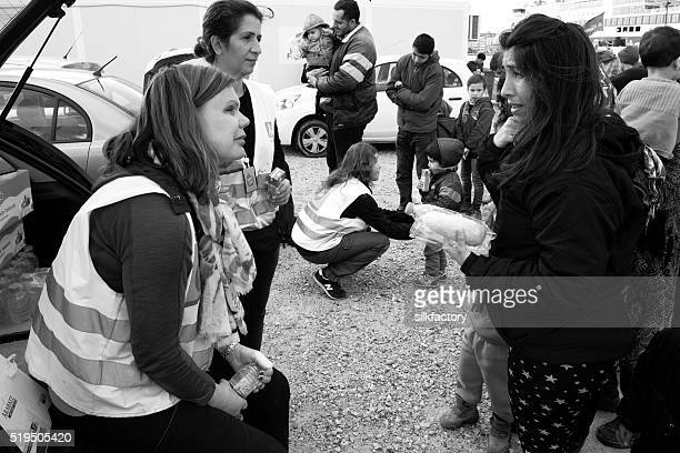 Worried refugee mother in food line in Chios refugee camp