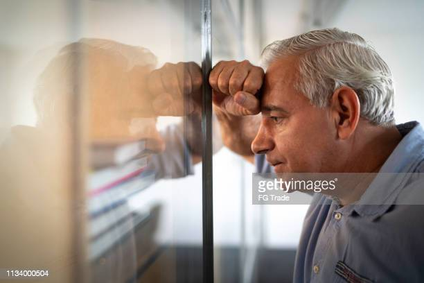 worried senior businessman feeling stressed at work - hopelessness stock pictures, royalty-free photos & images